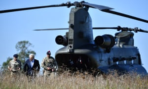 Boris Johnson arriving in a chinook helicopter to visit military personnel on Salisbury plain training area today.