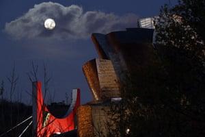 Super moon over the Guggenheim Museum in Bilbao, Spain