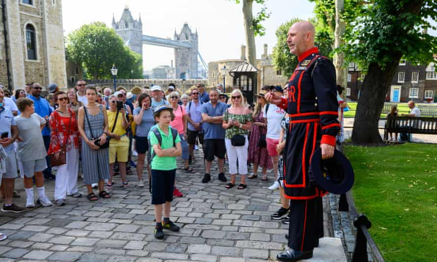 Yeoman Warder Barney Chandler leads a tour of the Tower of London