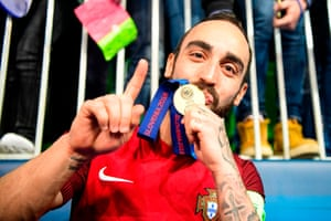 Ricardinho kisses his gold medal after Portugal won the 2018 European Futsal Championship in Slovenia.