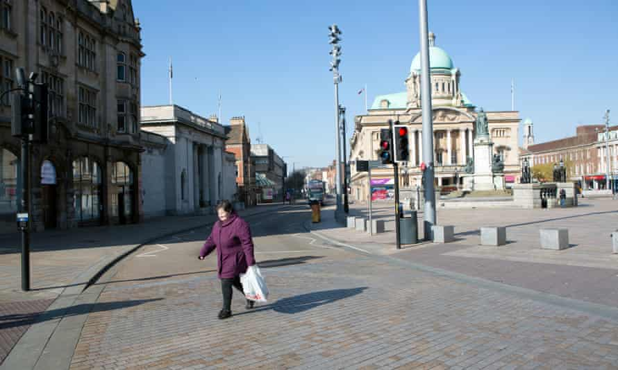 Hull town centre in daytime with one woman crossing a street