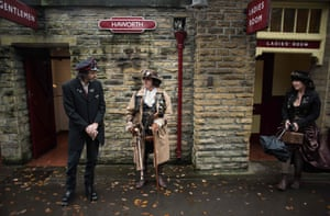 Steampunk enthusiasts wait for a steam train at Haworth station as they attend the sixth annual Haworth Steampunk Weekend in Haworth