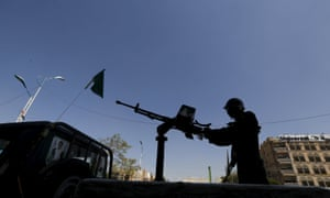 A Houthi militant mans a machine gun mounted on a truck in the capital, Sana'a.