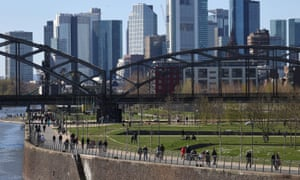 People at the embankment of the Main river during a partial lockdown in Frankfurt.