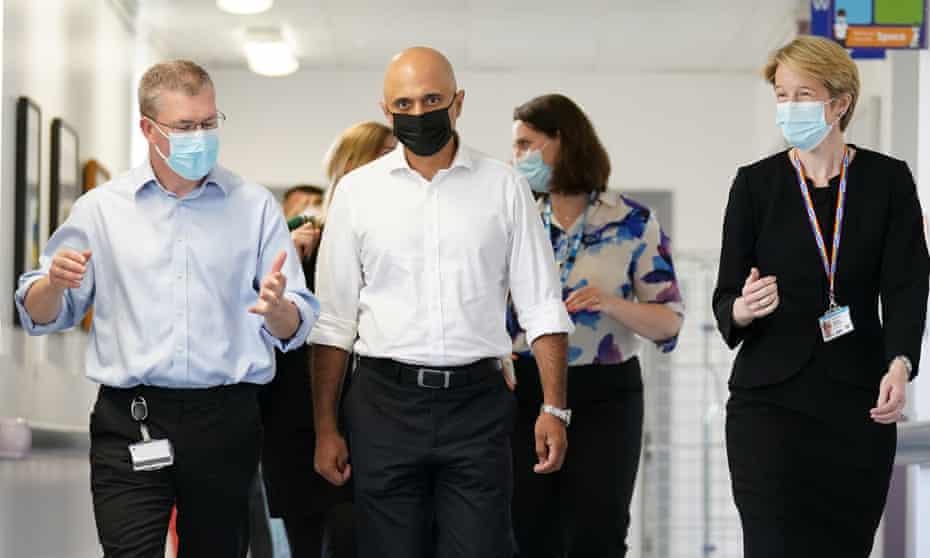 Health Secretary Sajid Javid (centre) alongside Amanda Pritchard, chief executive of NHS England, during a visit to Milton Keynes University hospital.