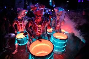 Three LED-illuminated theatrical drummers