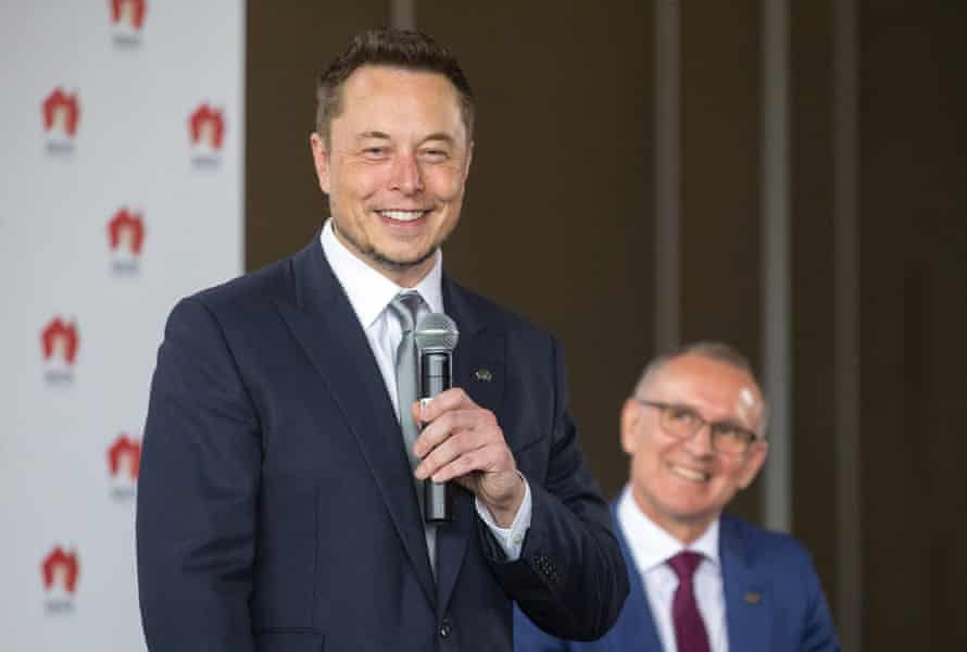 South Australian Premier Weatherill listens to Tesla Chief Executive Officer Musk speaking during an official ceremony in Adelaide