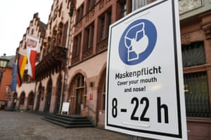 A sign reminding people to wear facial masks is seen on the plaza of Roemerberg in Frankfurt, Germany, on 20 January, 2021.