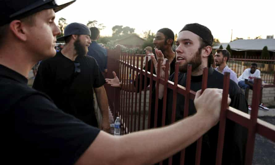 Members of the Islamic Community Center, including Ilyas Wadood (right), talk with people attending the 'Freedom of Speech Rally Round II' outside the center in Phoenix, Arizona.