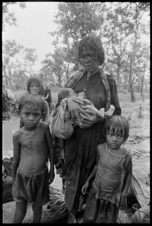 During the heavy monsoon in September 1979, travelling in the forest of Western Cambodia with a group of Cambodian guerilla favourable to Prince Sihanouk. People were walking across the forest to reach the border with Thailand in search of aid. This family, in fact stopped in their tracks as I approach to photograph them.