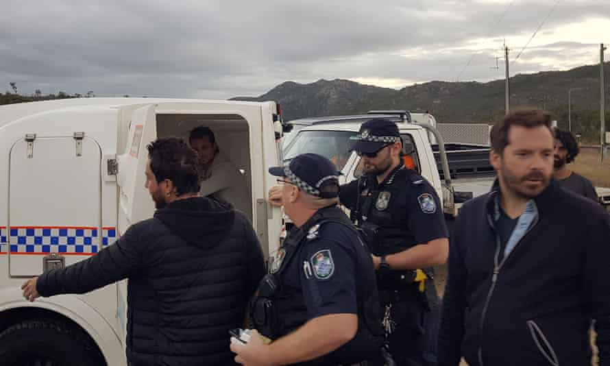 French journalists arrested covering an anti-Adani protest have been ordered by police not to go within 20km of the Carmichael mine site