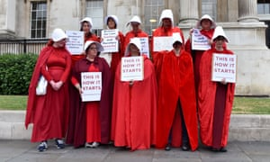 Protesters dressed as handmaids in London on Tuesday