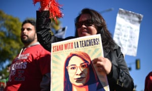 Striking public school teachers and their supporters march during the 34th annual Kingdom Day Parade on Martin Luther King Jr Day on Monday.