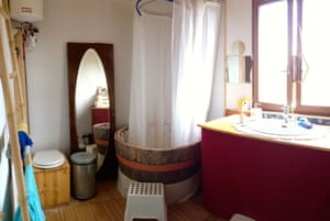 Upstairs, there are three bedrooms and a bathroom with barrel bath and dry toilet.