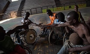 Simplice (in orange t-shirt) continues to be a member of the Central African Republic national para basketball team.