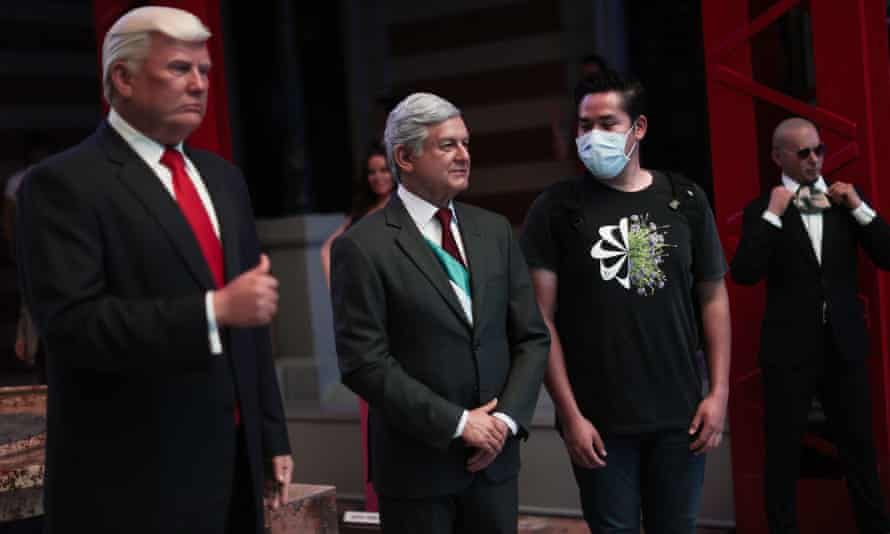 A visitors poses with wax figures of Donald Trump and Andres Manuel Lopez Obrador, at the Wax Museum in Mexico City.