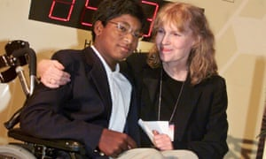 Mia Farrow poses with her adopted son Thaddeus in 2000 as they participate in the global summit on polio eradication at United Nations headquarters.