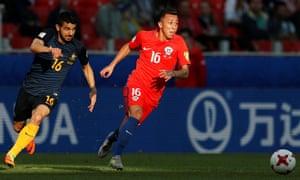 Aziz Behich chases Martin Rodriguez.
