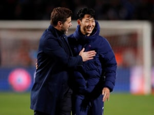 Son and Pochettino celebrate after their 4-0 win.