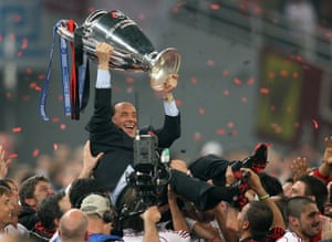 May 2007: Berlusconi lifts the trophy after AC Milan defeats Liverpool in the Champions League final in Athens