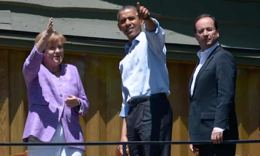 German Chancellor Angela Merkel , US President Barack Obama and French President Francois Hollande chat after they posed for a family photo during the G8 summit, May 2012 at the Camp David