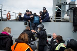Evacuees formerly stranded in Kaikoura board the New Zealand naval ship HMNZS Canterbury.