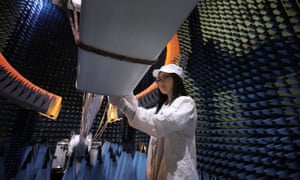 An engineer inspects an antenna at the Huawei village in Donnguan, China