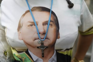 A supporter of Brazil's president elect, Jair Bolsonaro, wears a T-shirt with his likeness