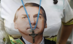 A supporter of Brazil's president elect Jair Bolsonaro wears a T-shirt with his likeness.