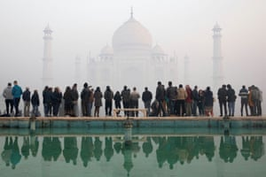 This photo from January shows a crowd of visitors huddled together looking at the Taj Mahal. Such scenes will not be permissible when the site re-opens on Monday