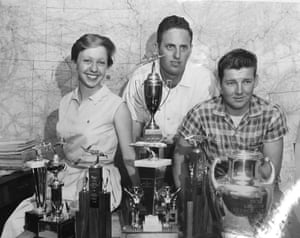 Funk and two other members of the Flying Aggies with the silverware they won, circa 1959