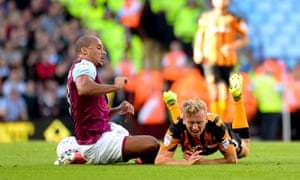 Hull City's Jarrod Bowen feels the force of a Gabriel Agbonlahor tackle.