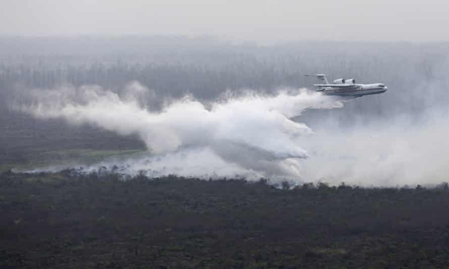 A leased Russian Beriev BE-200 water bomber drops its payload over a fire in Ogan Komering Ilir, South Sumatra.