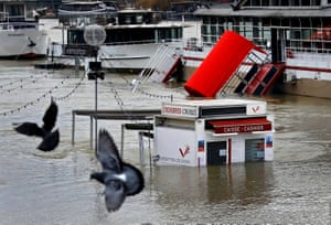 A ticket booth for sightseeing boats is partly submerged