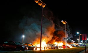 Cars burn at a car dealership in Ferguson, Missouri