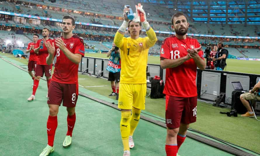 From left: Switzerland's Remo Freuler, Yann Sommer and Admir Mehmedi applaud their fans after the 3-1 win in Baku against Turkey.