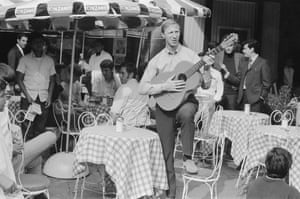Strumming a guitar as the team stroll around the Zona Rosa, Mexico City, during their shopping trip there during 1970 World Cup finals.
