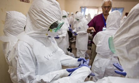 WHO staff training nurses to use protective gear in Freetown, Sierra Leone during the 2014 ebola outbreak.