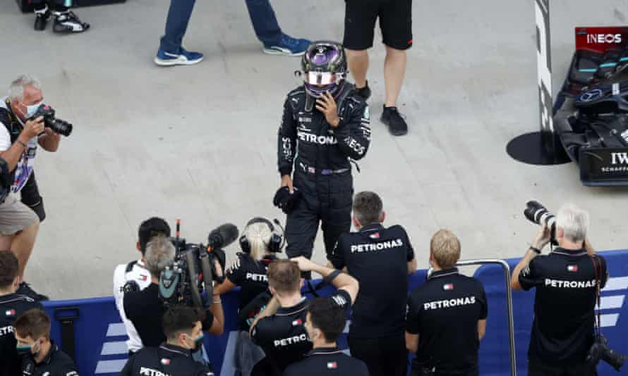 Lewis Hamilton with his Mercedes pit crew.