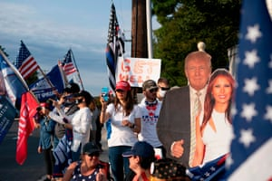TOPSHOT-US-POLITICS-TRUMP-HEALTH-VIRUSTOPSHOT - Supporters of the US president hold flags as they rally outside of Walter Reed Medical Center in Bethesda, Maryland on October 4, 2020, where the president is being treated for Covid-19. - US President Donald Trump waved at supporters from a motorcade on October 4 on a short drive outside the hospital where he was being treated for Covid-19. (Photo by Alex Edelman / AFP) (Photo by ALEX EDELMAN/AFP via Getty Images)