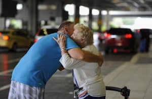 Rick Surette hugs his mother-in-law Jacqulyn Umhoefer. Surette drove four hours to drop the 92-year-old off at Tampa International Airport so she could stay with her daughter in New Jersey during the storm.