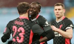 Liverpool's Sadio Mane celebrates scoring their third goal with Xherdan Shaqiri.