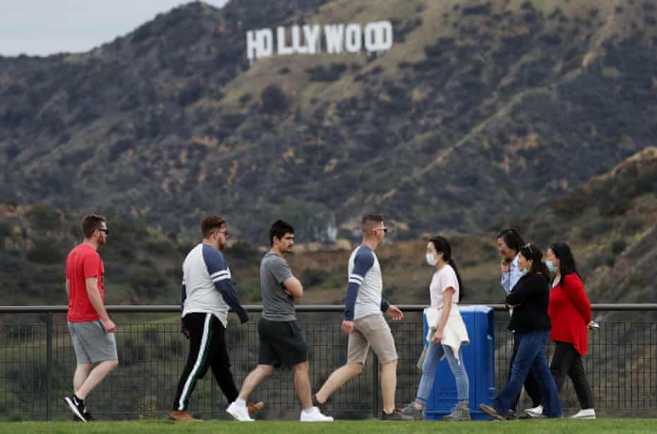 Groups of people walk in Griffith Park in Los Angeles after Governor Gavin Newsom issued a stay-at-home order for all of California.