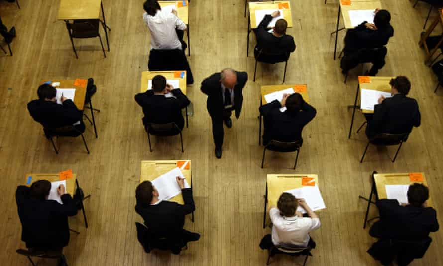general view of pupils sitting an exam