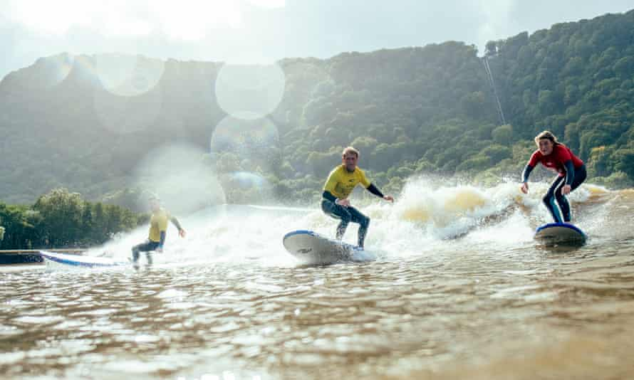 Surfers on the surf lagoon at Adventure Parc Snowdonia