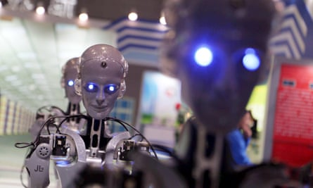 Robots manufactured by Shaanxi Jiuli Robot Manufacturing Co on display at a technology fair in Shanghai