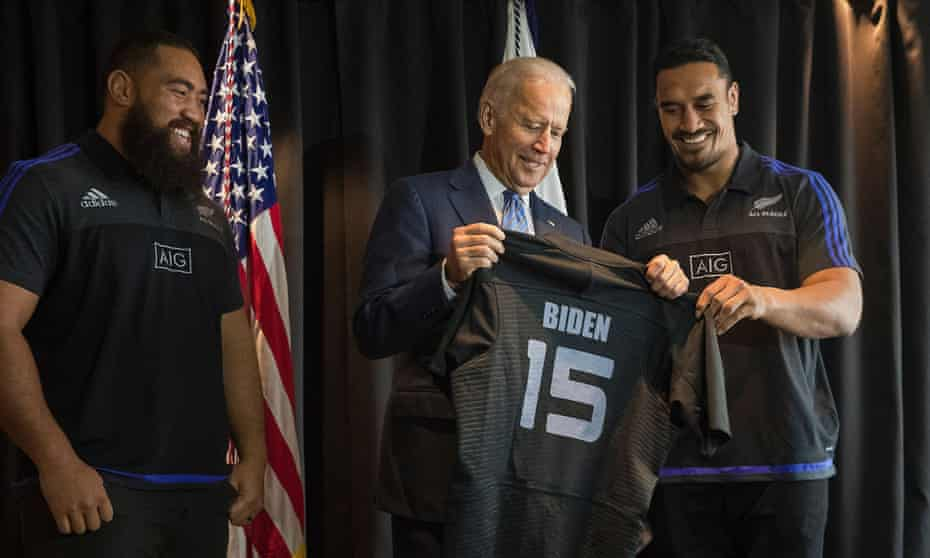 Joe Biden, then vice-president, receives a personalised All Black rugby jersey from Jerome Kaino and Charlie Faumuina in Auckland in 2016.
