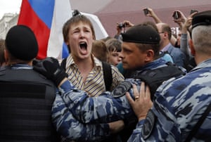 A young demonstrator shouts as he is blocked by police during a rally in Moscow