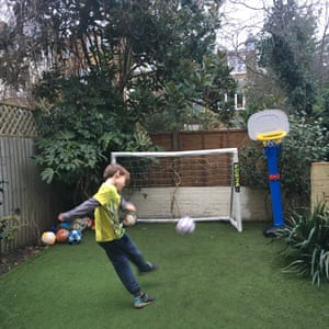 James playing football in his garden