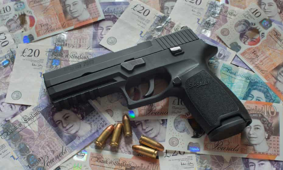 Sig Sauer P25 pistol and 9mm.ammunition with dollar bills and with British pound notes